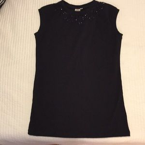Sleeveless black top with beading